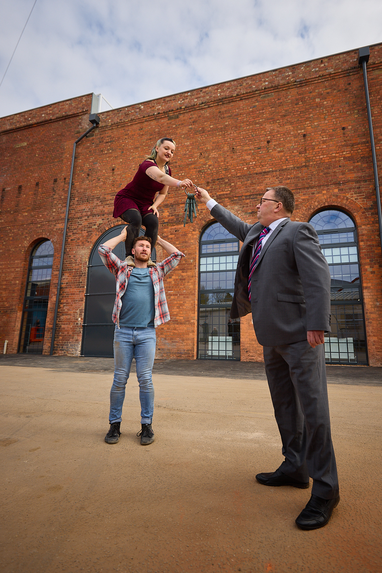Performers Luka Owen and Daniel Connor receive the keys to the Daimler Powerhouse from Robert Wigley