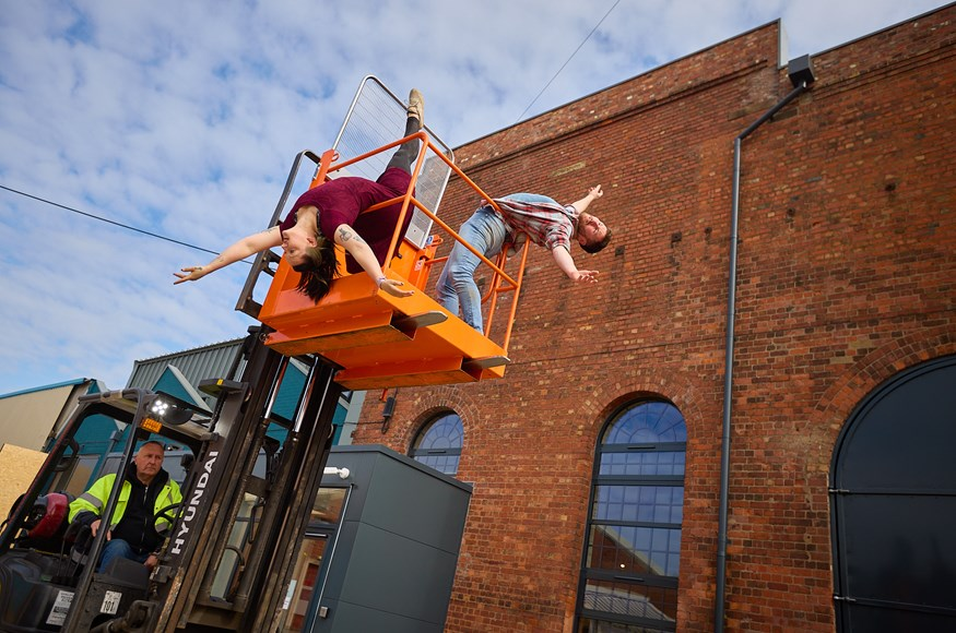 Aerialists Luka Owen and Daniel Connor perform with a fork lift truck at the opening of the Daimler Powerhouse Creation Centre